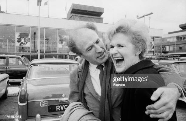 English-Canadian actor Barry Morse with his wife, actress Sydney Sturgess at London Airport, UK, 30th March 1966.