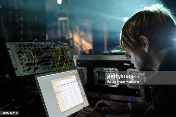English-Canadian DJ and musician Richie Hawtin preparing for a performance at Bestival on the Isle of Wight, September 10, 2010.