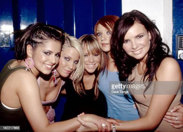 EnglishIrish pop group Girls Aloud pose back stage at a TV show London 2003 LR Cheryl Tweedy Sarah Harding Kimberley Walsh Nicola Roberts and Nadine...
