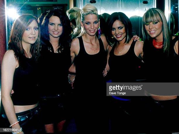 EnglishIrish pop group Girls Aloud pose back stage at a TV show London 2003 LR Nicola Roberts Nadine Coyle Sarah Harding Cheryl Tweedy and Kimberley...