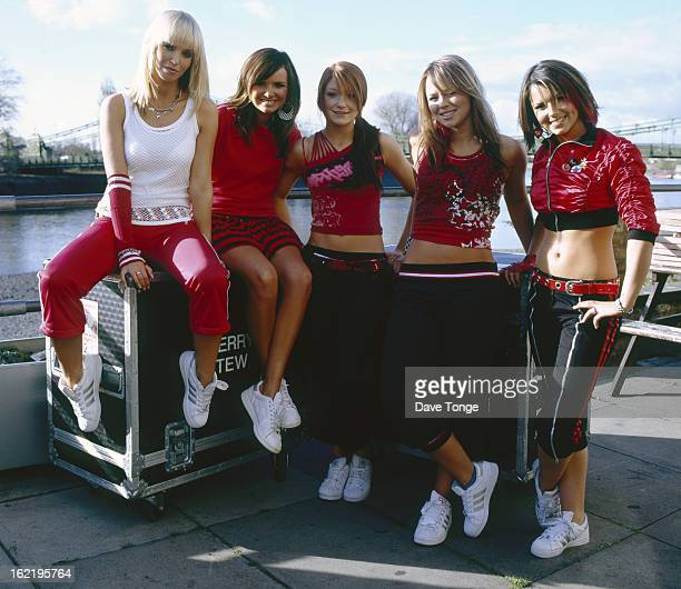 EnglishIrish pop group Girls Aloud pose on the banks of the River Thames Hammersmith London 2003 LR Sarah Harding Nadine Coyle Nicola Roberts...