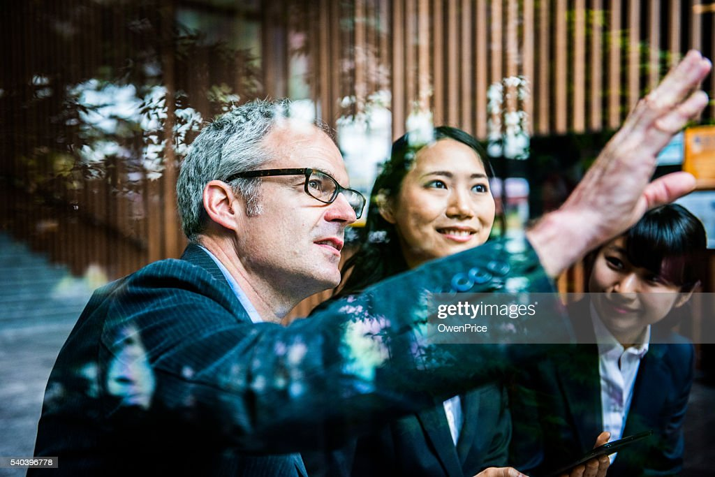 Englishman discussing concept with Japanese team : Stock Photo