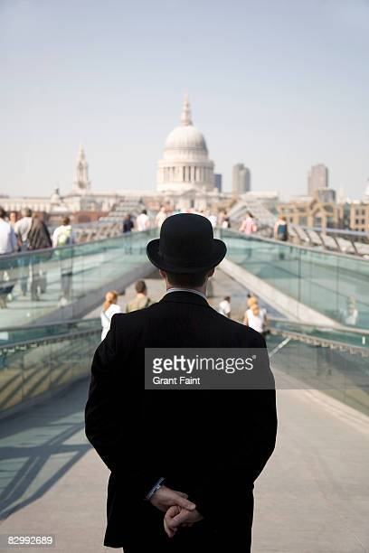 englishman standing near millennium bridge - hat stock pictures, royalty-free photos & images