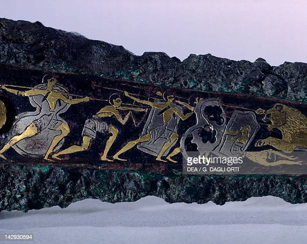 Engraved dagger in gold silver bronze and niello from Tomb IV of the Circle A of Mycenae Detail showing lion hunting Goldsmith art Mycenaean...