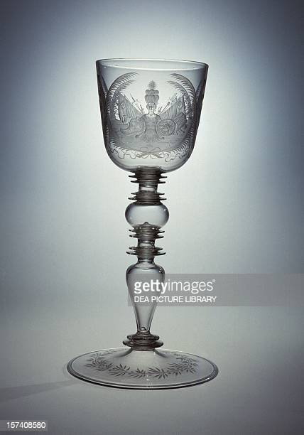 Engraved glass goblet by Hermann Schwinger with the coats of arms of patricians 16701690 Nuremberg Germany 17th century Corning Corning Museum Of...