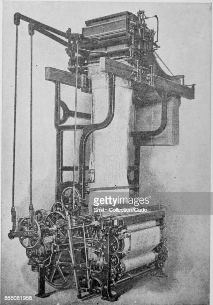 Engraved image of a Jacquard silk loom with a motor drive and early example of industrial automation Jacquard looms use the patterns punched on a...