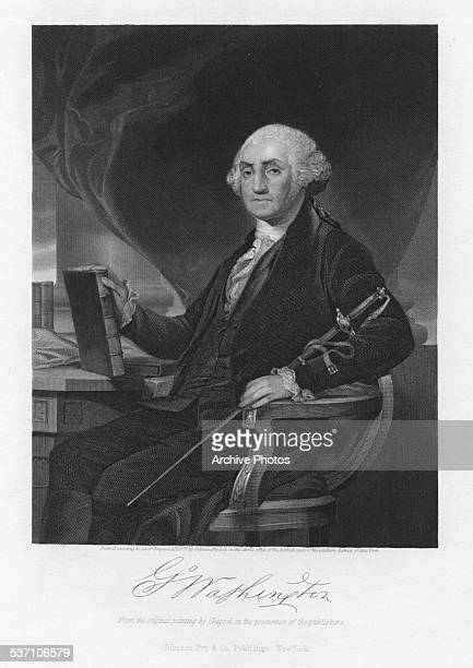 Engraved portrait of US President George Washington seated at a desk holding a sword and book with his signature circa 1780 Engraved from the...