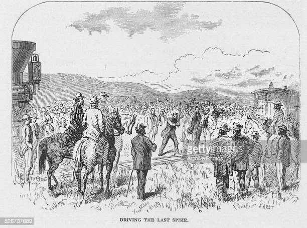 Engraved scene depicting a crowd watching the driving of the last spike upon the completion of the first continental railroad Promontory Utah May...