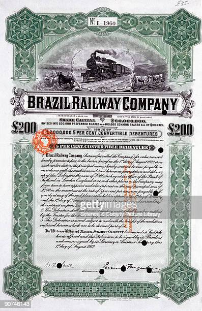 Engraved share certificate issued on behalf of the Brazil Railway Company including an decorative border and vignette showing a steam locomotive and...