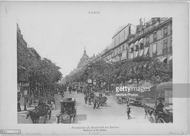 Engraved view along the Boulevard des Italiens one of the four grand boulevard's in Paris bustling with the activity of horsedrawn carts and hansom...