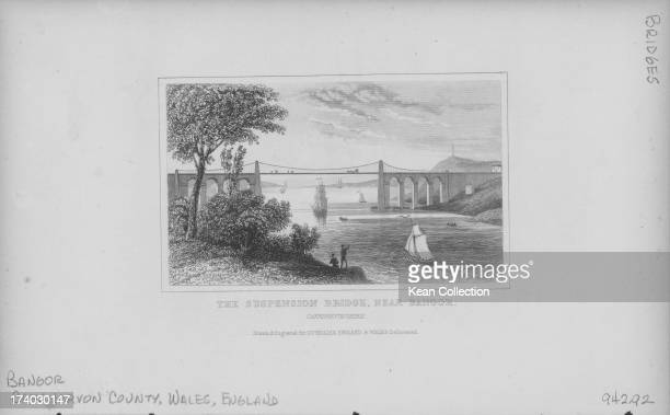Engraved view the Menai Suspension Bridge or Pont Grog y Borth near Bangor a suspension bridge between the island of Anglesey and the mainland of...
