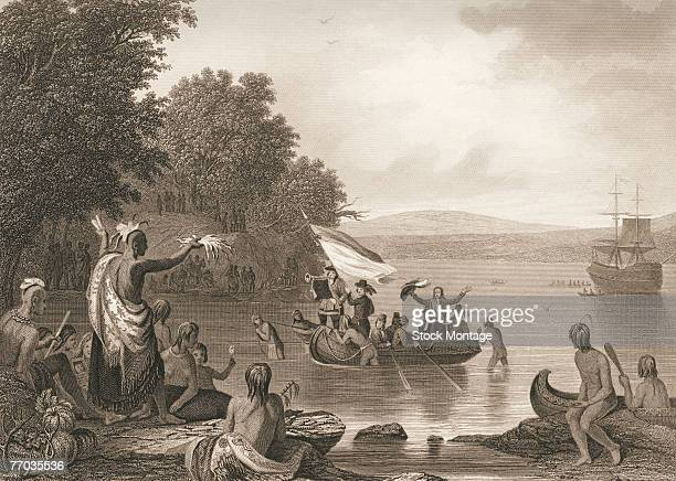 Engraving after a Robert Weir painting entitiled 'The Landing Of Hendrick Hudson' shows British explorer Henry Hudson has he arrives ashore greeted...