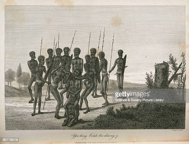 Engraving by Neagle of part of an initiation ritual A boy is held while a man knocks out a front tooth This ritual took place at Yoolahng near Farm...