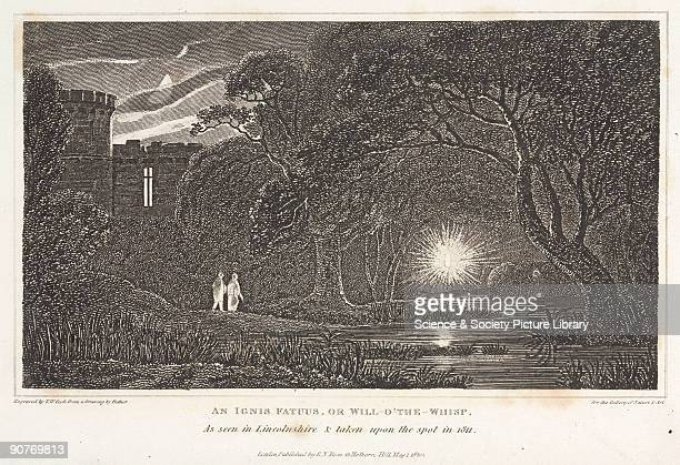 Engraving by T W Cook after a drawing by Pether taken on the spot in Lincolnshire 1811 showing two men watching a bright light which is hovering...