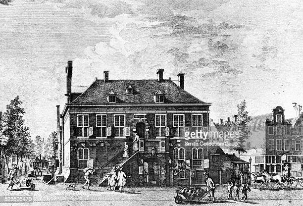 Engraving depicting a busy street and a three story brick building captioned The West India Company's house Haarlemmer Straat Amsterdam Amsterdam...