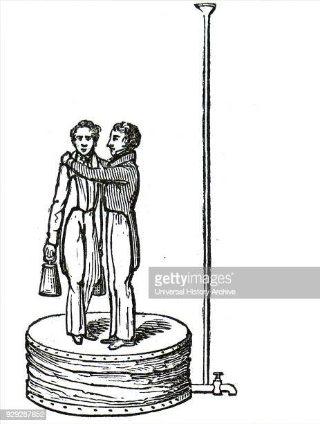 Engraving depicting a hydrostatic bellows The men standing on the bellows can be lifted by pouring a small quantity of water down tube at the right...
