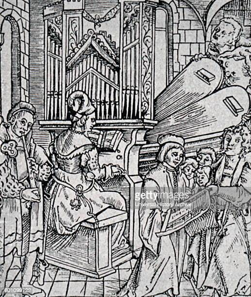 Engraving depicting a large organ being played by an organist Dated 16th Century