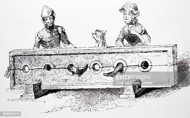 Engraving depicting a man and woman in stocks. Dated 15th Century.