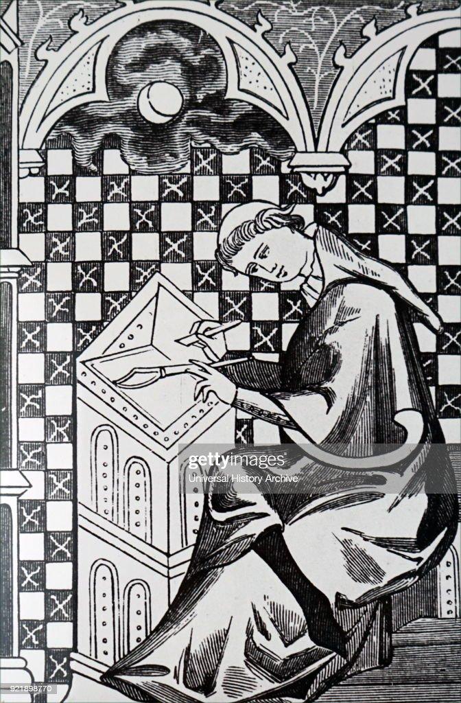 A monk copying a manuscript. : News Photo