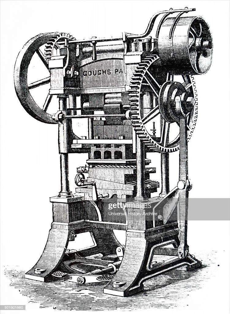 A patent rotary 'arming' press. : News Photo