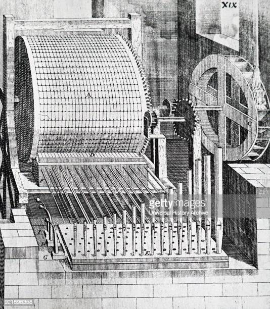 Engraving depicting a water driven mechanical organ The engraving depicts how the pins on the revolving drum open and close the pipes Dated 17th...
