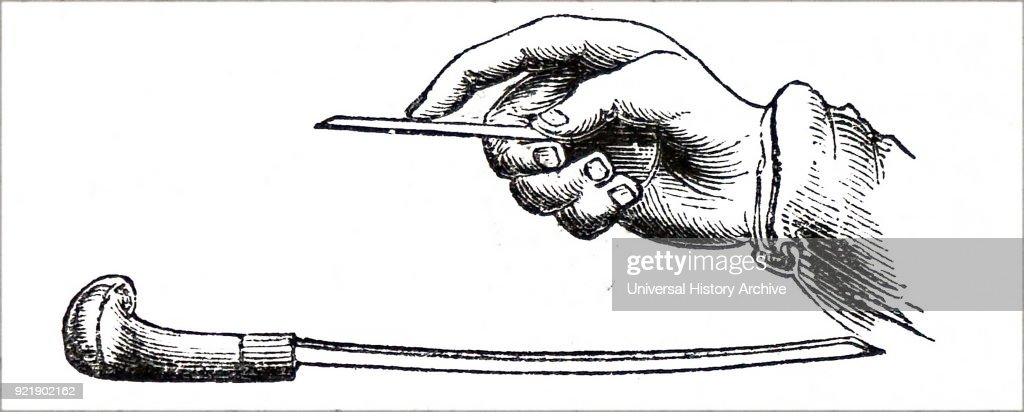Engraving depicting an engraver engraving a copperplate using a steel burin. Dated 19th century.