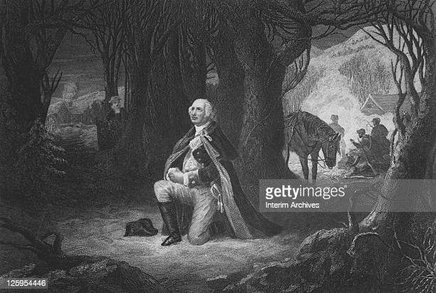 Engraving depicting General George Washington kneeling in prayer while his soldiers camp in the background at Valley Forge Pennsylvania during the...