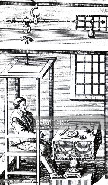 Engraving depicting Santorio Santorio seated in his balance in which he could eat and sleep He was the first to perform experiment on the metabolism...
