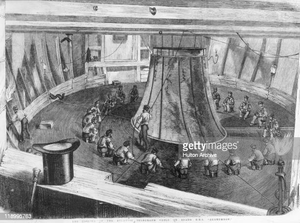 Engraving depicting the coiling of the Atlantic telegraph cable onboard HMS Agamemnon with the crewmen sitting in a circle aroud the coil 1857...
