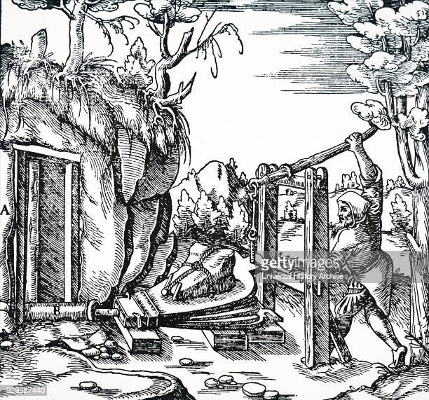 Engraving depicting the use of a lever to work bellows ventilating a mine Dated 16th Century