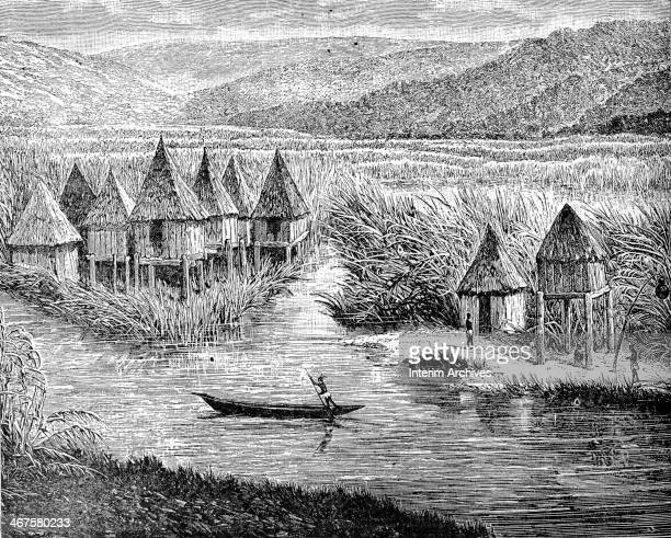 Engraving depicts a figure who steers a canoe past a village on the shores of Lake Chad Africa nineteenth century