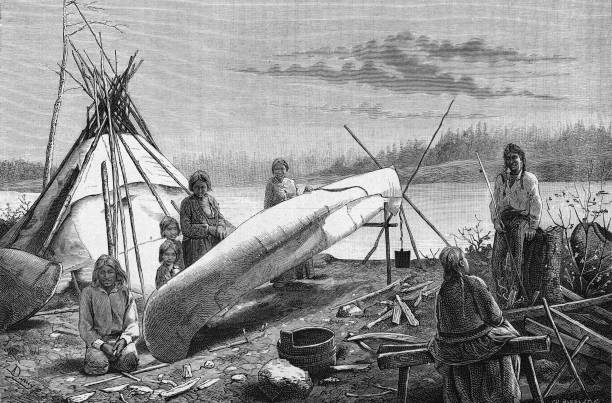 Engraving depicts an Ojibwe camp on the bank of a river,...