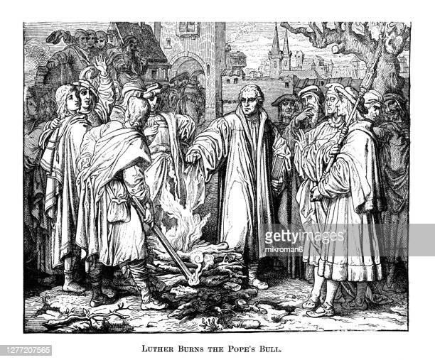 engraving illustration of of martin luther burns the papal bull in wittenberg - pope stock pictures, royalty-free photos & images
