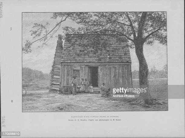Engraving of a small wooden dwelling, home to an Afro-American family in Florida, circa Early 20th Century.
