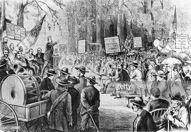 Engraving of an openair meeting held by the Granges an populist farmer's association organized in the western United States where a speaker hold...