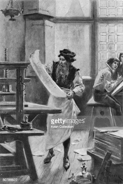 Engraving of German printer Johannes Gutenberg checking a page in his workshop while printing his first 42line Bible on his printing press with...