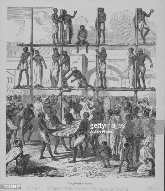 Engraving of penitent Hindus throwing themselves from high on the scaffold onto mats held below to atone for their sins, as crowds celebrate and play...