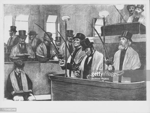 Engraving of the Feast of the Tabernacles being celebrated in a North London Synagogue in 1872. The three men on the dais are holding palm branches.
