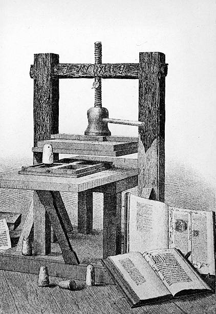 Engraving of the first printing press, invented by...
