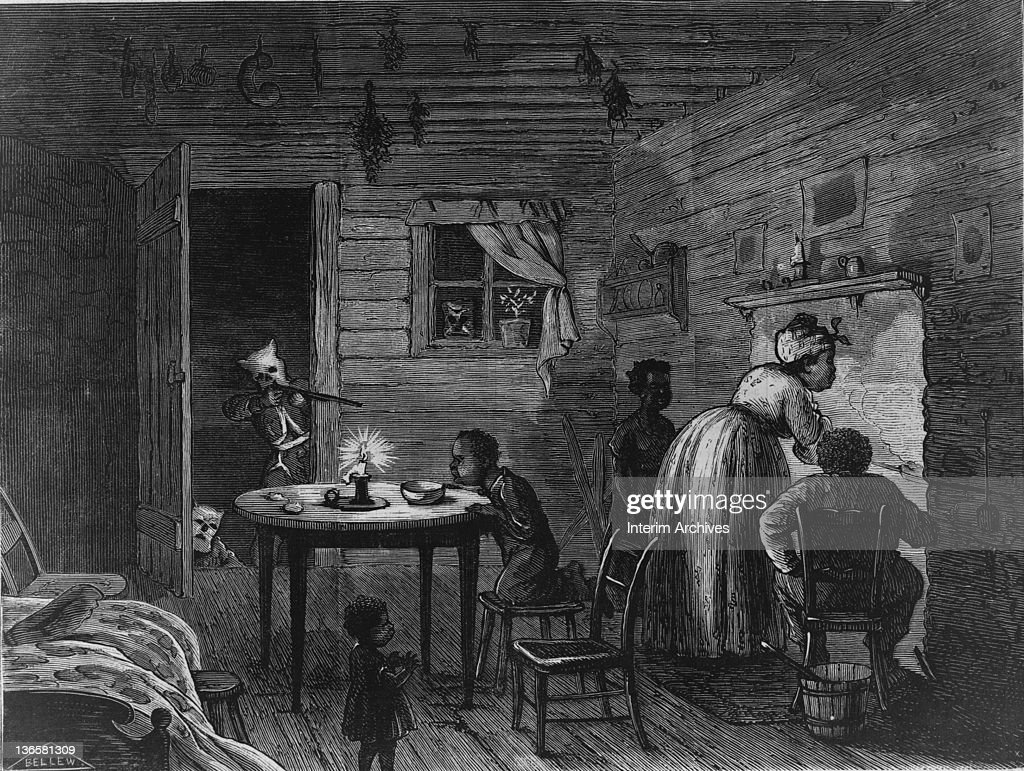 Engraving showing an African American family, a woman cooking, a man seated by the fire, and their three children unaware that a member of the Ku Klux Klan is aiming a rifle at them through their doorway, 1872. Engraving by Frank Bellew.
