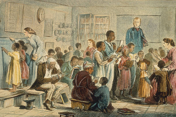 Engraving showing freed black slaves learning to read...