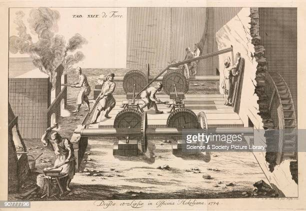 Engraving showing metalworkers heating hammering and shaping iron The waterwheel powers rollers used to flatten the metal into sheets from �Regnum...