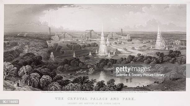 Engraving showing the Crystal Palace with fountains gardens and an artificial lake featuring islands decorated with models of dinosaurs dodos and...