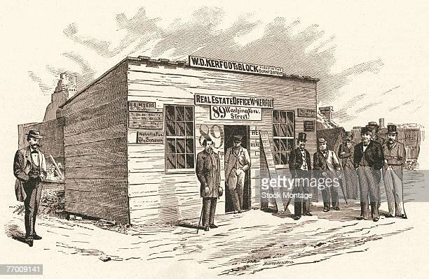 Engraving shows a group of men as they pose outside WD Kerfoot's Real Estate Office a wooden structure labelled as the first building in the burned...
