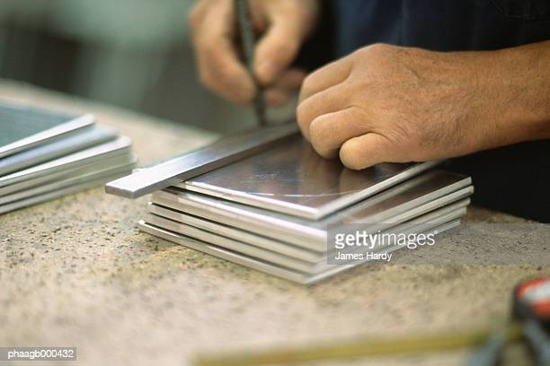 Engraving squares of aluminum