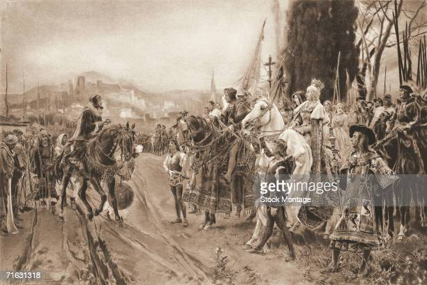 Engravnig shows the surrender of the Moors to King Ferdinand II and Queen Isabella of Castille Granada Spain January 2 1492