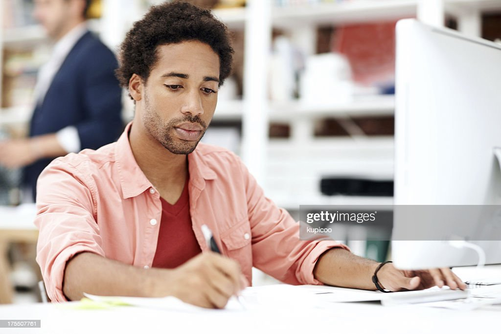 Engrossed in his work : Stock Photo