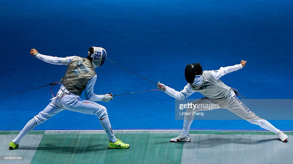 Enguerand Roger (L) of France and Guillaume Bianchi of Italy compete in the Men's Foil Individual Quarterfinal on day three of the Nanjing 2014 Summer Youth Olympic Games at Nanjing International Expo Centre on August 19, 2014 in Nanjing, China.