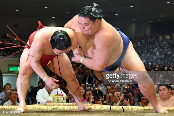 Enho throws Daishoho to win on day four of the Grand Sumo May Tournament at Ryogoku Kokugikan on May 15, 2019 in Tokyo, Japan.