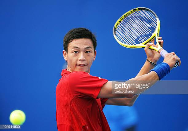 En-Hsun Lu of Chinese Taipei plays a backhand during his match against David Ferrer of Spain during day seven of the 2010 China Open at the National...